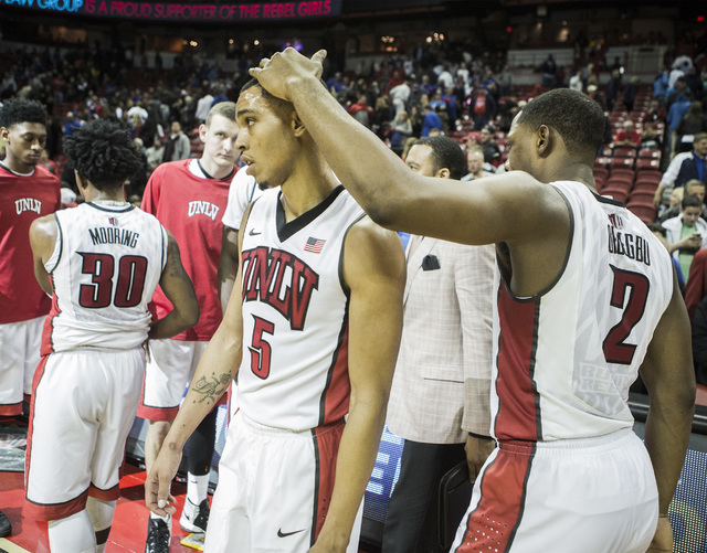 UNLV guard Uche Ofoegbu, right, consoles Jalen Poyser after the Rebels loss to Kansas at the Thomas and Mack Center on Thursday, Dec. 22, 2016. Kansas defeated the Rebels, 71-53. (Jeff Scheid/Las  ...