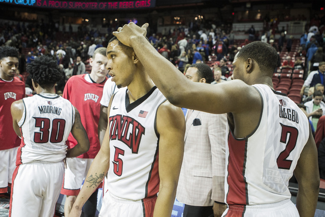 UNLV guard Uche Ofoegbu, right, consoles Jalen Poyser after the Rebels loss to Kansas at the Thomas and Mack Center on Thursday, Dec. 22, 2016. The Jayhawks defeated the Rebels, 71-53. Jeff Scheid ...