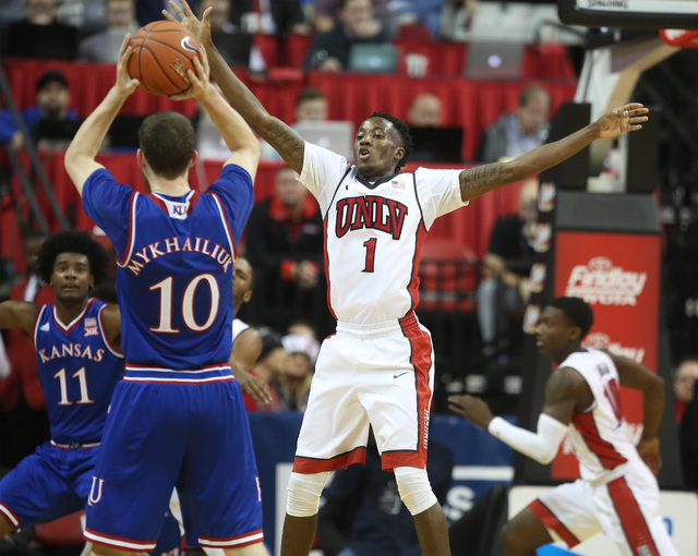 UNLV Kris Clyburn puts pressure on Kansas Jayhawks guard Sviatoslav Mykhailiuk during the second half at the Thomas and Mack Center on Thursday, Dec. 22, 2016. Kansas defeated the Rebels, 71-53. ( ...
