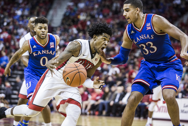 UNLV guard Jovan Mooring drives on  Kansas Jayhawks center Lucas Landen during second half action at the Thomas and Mack Center on Thursday, Dec. 22, 2016. Kansas defeated the Rebels, 71-53. (Jeff ...