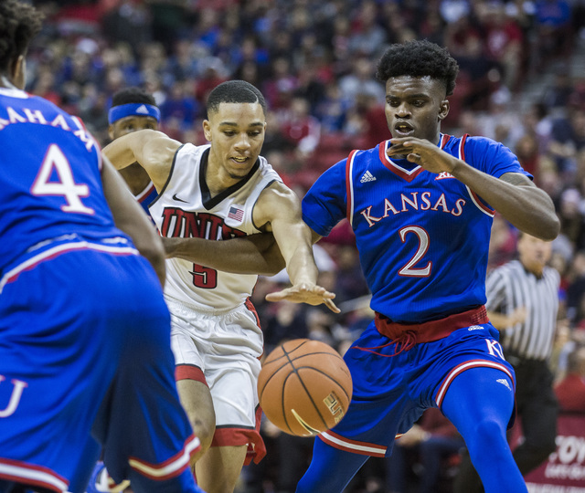 UNLV guard Jalen Poyser drives through the Kansas Jayhawks defense during second half action at the Thomas and Mack Center on Thursday, Dec. 22, 2016. Kansas defeated the Rebels, 71-53. (Jeff Sche ...