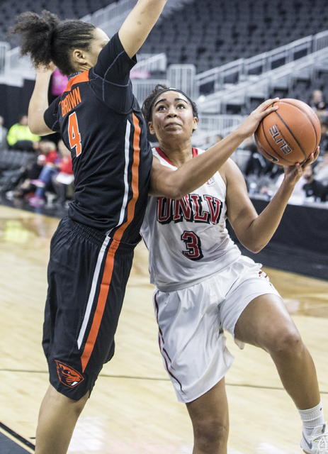 UNLV's Paris Strawther (3) drives past Oregon State's  Breanna Brown (4) during the Play4Kay Shootout at T-Mobile Arena on Monday, Dec. 19, 2016, in Las Vegas. Benjamin Hager/Las Vegas Review-Journal
