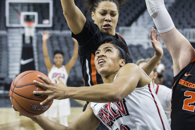 UNLV's Nikki Wheatley (10) slashes to the rim past Oregon State's Marie Gülich (21) during the Play4Kay Shootout at T-Mobile Arena on Monday, Dec. 19, 2016, in Las Vegas. Benjamin Hager/Las V ...