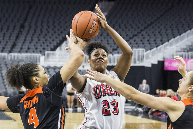 UNLV's Jordyn Bell (23) shoots over Oregon State's Breanna Brown (4) during the Play4Kay Shootout at T-Mobile Arena on Monday, Dec. 19, 2016, in Las Vegas. Benjamin Hager/Las Vegas Review-Journal
