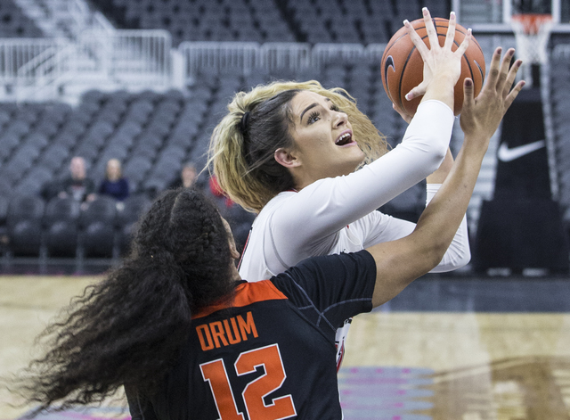 UNLV's Katie Powell (21) drives past Oregon State's  Kolbie Orum (12) during the Play4Kay Shootout at T-Mobile Arena on Monday, Dec. 19, 2016, in Las Vegas. Benjamin Hager/Las Vegas Review-Journal