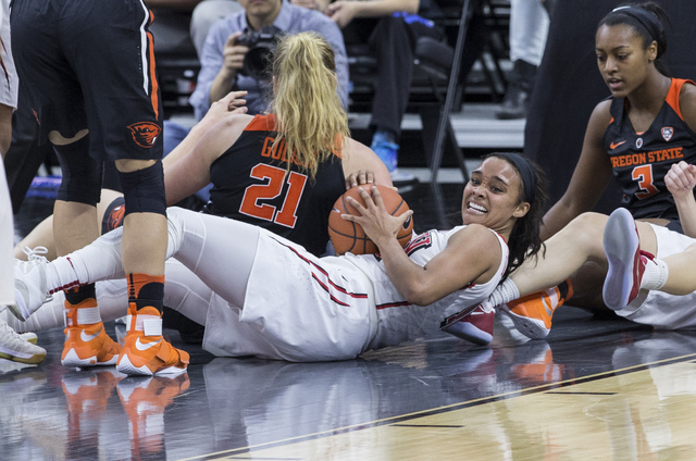 UNLV's Dakota Gonzalez (12) fights for a loose ball with Oregon State's  Marie Glich (21) during the Play4Kay Shootout at T-Mobile Arena on Monday, Dec. 19, 2016, in Las Vegas. Benjamin Hager/Las  ...