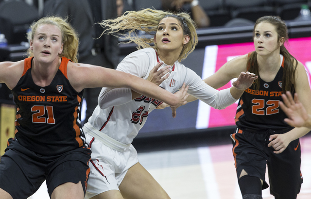 UNLV's Katie Powell (21) fights for a rebound with Oregon State's Marie Glich (21) and Kat Tudor (22) during the Play4Kay Shootout at T-Mobile Arena on Monday, Dec. 19, 2016, in Las Vegas. Benjami ...