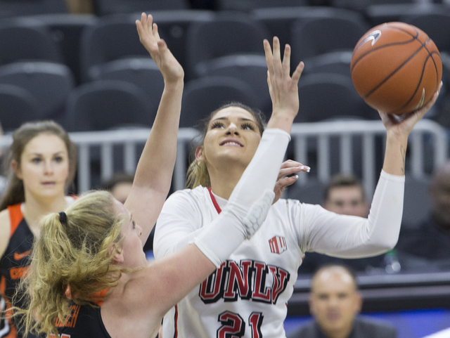UNLV's Katie Powell (21) shoots over Oregon State's  Marie Glich (21) during the Play4Kay Shootout at T-Mobile Arena on Monday, Dec. 19, 2016, in Las Vegas. Benjamin Hager/Las Vegas Review-Journal