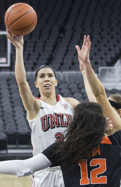 UNLV's Brooke Johnson (2) shoots over Oregon State's  Kolbie Orum (12) during the Play4Kay Shootout at T-Mobile Arena on Monday, Dec. 19, 2016, in Las Vegas. Benjamin Hager/Las Vegas Review-Journal