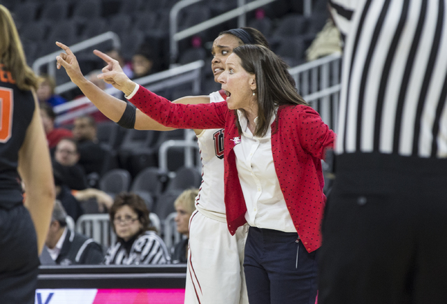 UNLV's head coach Kathy Olivier shouts out a play call with Dylan Gonzalez (11) during the Play4Kay Shootout at T-Mobile Arena on Monday, Dec. 19, 2016, in Las Vegas. Benjamin Hager/Las Vegas Revi ...