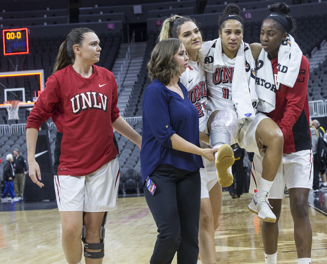 UNLV's Nikki Wheatley (10) is carried off the court after being injured during the Oregon State game at the Play4Kay Shootout at T-Mobile Arena on Monday, Dec. 19, 2016, in Las Vegas. Benjamin Hag ...