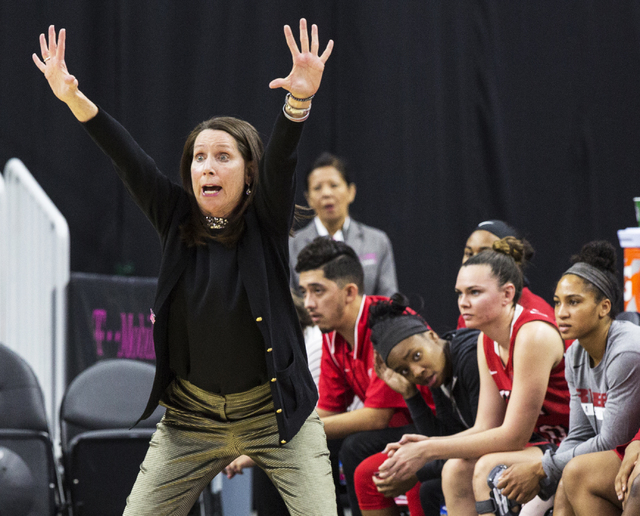 UNLV head coach Kathy Olivier calls an offensive play during the Rebels home matchup with New Mexico State during the  Play4Kay Shootout at T-Mobile Arena on Tuesday, Dec. 20, 2016, in Las Vegas.  ...