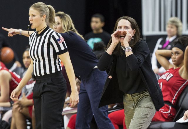 UNLV head coach Kathy Olivier, right, screams at her offense during the Rebels home matchup with New Mexico State during the  Play4Kay Shootout at T-Mobile Arena on Tuesday, Dec. 20, 2016, in Las  ...