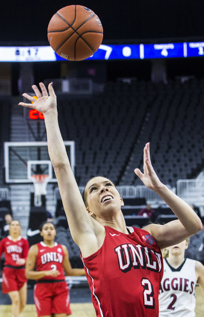 UNLV's Brooke Johnson (2) shoots over New Mexico State defenders during the Play4Kay Shootout at T-Mobile Arena on Tuesday, Dec. 20, 2016, in Las Vegas. Benjamin Hager/Las Vegas Review-Journal