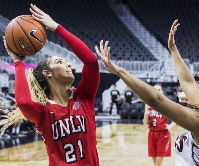 UNLV's Katie Powell (21) shoots a jump shot over New Mexico State's Tyler Ellis (22) during the Play4Kay Shootout at T-Mobile Arena on Tuesday, Dec. 20, 2016, in Las Vegas. Benjamin Hager/Las Vega ...