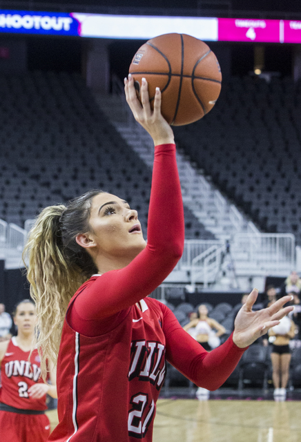 UNLV's Katie Powell (21) converts a fast break layup  during the Play4Kay Shootout at T-Mobile Arena on Tuesday, Dec. 20, 2016, in Las Vegas. Benjamin Hager/Las Vegas Review-Journal
