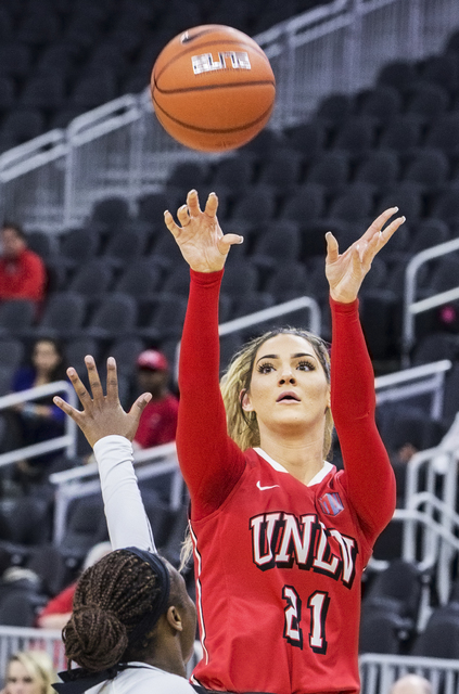 UNLV's Katie Powell (21) shoots over New Mexico State's Tonishia Childress (3) during the Play4Kay Shootout at T-Mobile Arena on Tuesday, Dec. 20, 2016, in Las Vegas. Benjamin Hager/Las Vegas Revi ...