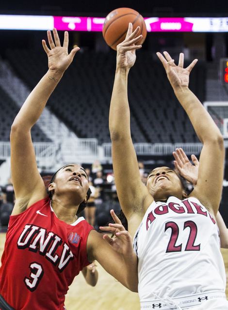 UNLV's Paris Strawther (3) fights for a rebound with New Mexico State's Tyler Ellis (22) during the Play4Kay Shootout at T-Mobile Arena on Tuesday, Dec. 20, 2016, in Las Vegas. Benjamin Hager/Las  ...
