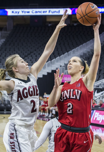 UNLV's Brooke Johnson (2) shoots a jump shot over New Mexico State's Brooke Salas (2) during the Play4Kay Shootout at T-Mobile Arena on Tuesday, Dec. 20, 2016, in Las Vegas. Benjamin Hager/Las Veg ...