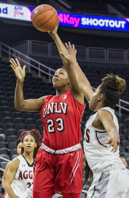 UNLV's Jordyn Bell (23) shoots over New Mexico State's Gia Pack (30) during the Play4Kay Shootout at T-Mobile Arena on Tuesday, Dec. 20, 2016, in Las Vegas. Benjamin Hager/Las Vegas Review-Journal