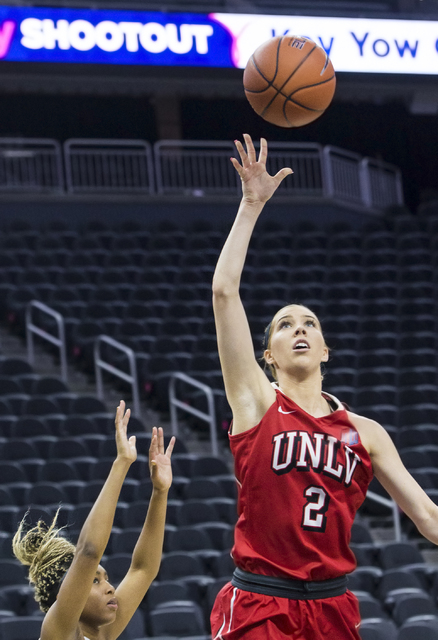 UNLV's Brooke Johnson (2) drives past New Mexico State's Zaire Williams (12) during the Play4Kay Shootout at T-Mobile Arena on Tuesday, Dec. 20, 2016, in Las Vegas. Benjamin Hager/Las Vegas Review ...