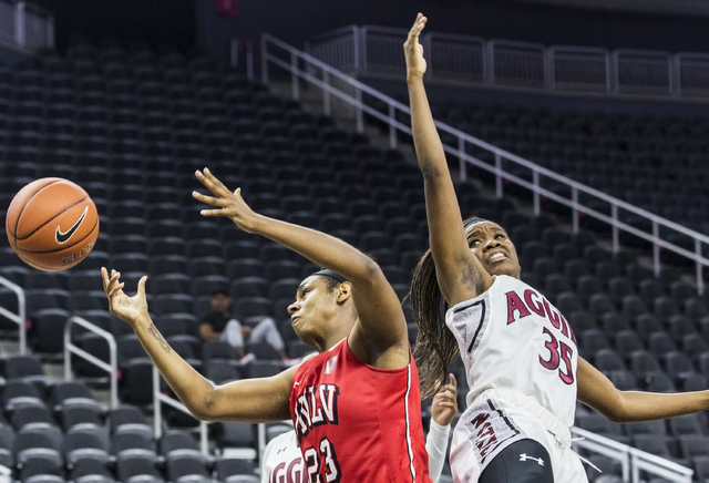 UNLV's Jordyn Bell (23) fights for a loose ball with New Mexico State's Moriah Mack (35) during the Play4Kay Shootout at T-Mobile Arena on Tuesday, Dec. 20, 2016, in Las Vegas. Benjamin Hager/Las  ...