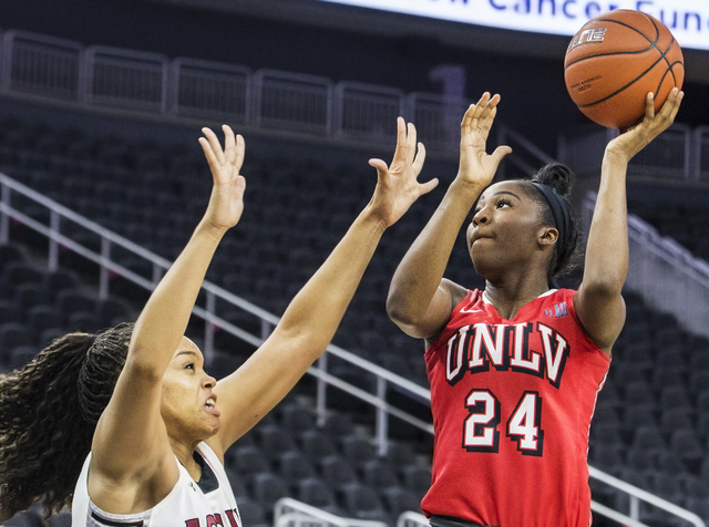 UNLV's Rodjanae Wade (24) shoots a jump shot over New Mexico State's  Tyler Ellis (22) during the Play4Kay Shootout at T-Mobile Arena on Tuesday, Dec. 20, 2016, in Las Vegas. Benjamin Hager/Las Ve ...