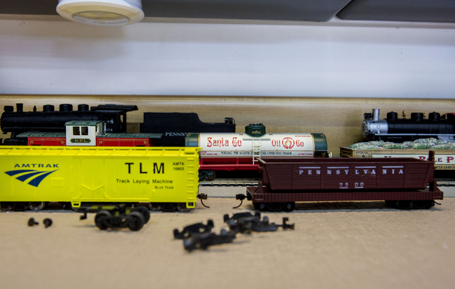 An array of freelance Pennsylvania railroad model train parts wait to be constructed and added to Jim Henry's working collection, in his North Las Vegas home, Tuesday, Dec. 13, 2016. (Elizabeth Pa ...