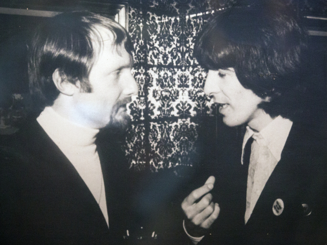 Douglas Cox, left, chats with the Beatles George Harrison during a party at the Playboy Mansion in Los Angles in the  late 1960's.  (Courtesy photo)