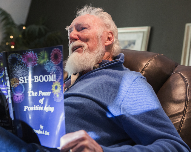 Douglas Cox holds his self publish motivational book while sitting in his Henderson home on Wednesday, Nov. 30, 2016. (Jeff Scheid/Las Vegas Review-Journal) Follow @jeffscheid