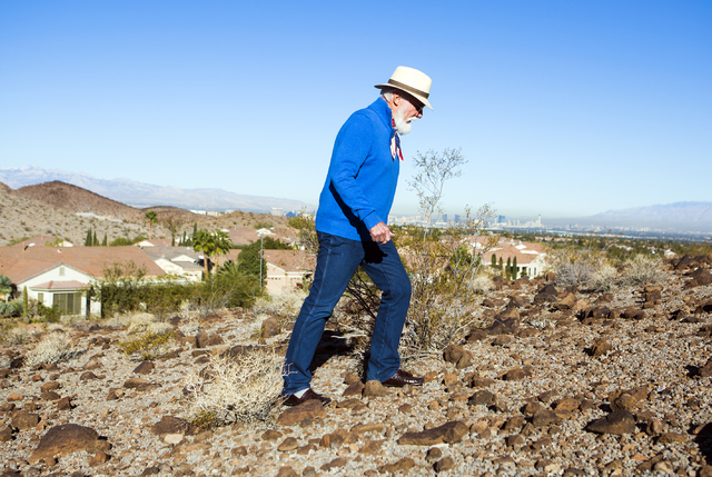 Author and motivational speaker Douglas Cox walks up a hill behind his Henderson home on Wednesday, Nov. 30, 2016. (Jeff Scheid/Las Vegas Review-Journal) @jeffscheid