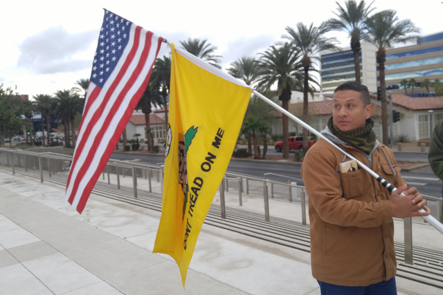 Joshua Martinez, 28, of Las Vegas, stands outside the Lloyd D. George U.S. Courthouse on Friday to show support for Ryan Bundy, who was in court. (Ben Botkin/Las Vegas Review-Journal) @benbotkin1