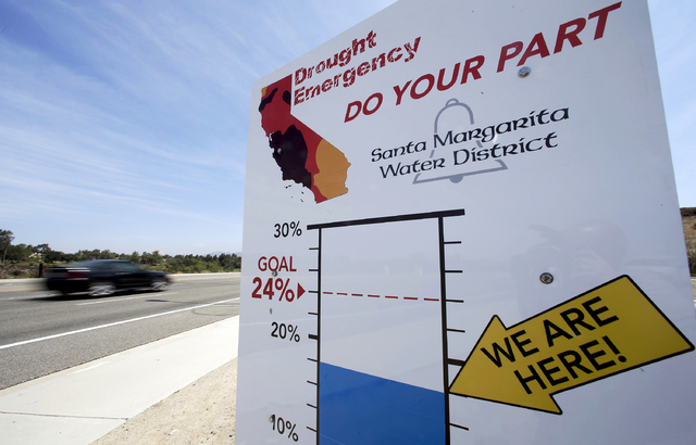 A sign in Rancho Santa Margarita, Calif., encourages residents to save water in 2015. (AP Photo/Chris Carlson)