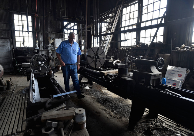 John Campbell walks among his equipment inside his machine workshop Thursday, June 9, 2016, in Tonopah, Nev. The third-generation Tonopah resident still uses the presses and lathes that his grandf ...