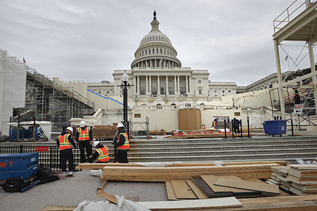 Construction continues on the Inaugural platform in preparation for the Inauguration and swearing-in ceremonies for President-elect Donald Trump, Thursday, Dec. 8, 2016, on the Capitol steps in Wa ...