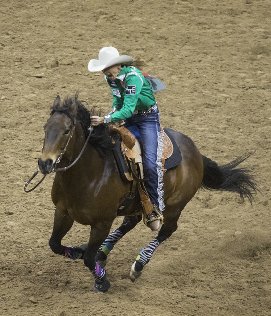 Pamela Capper competes in the barrel racing event during the fourth day of the National Finals Rodeo at the Thomas & Mack Center in Las Vegas on Sunday, Dec. 4, 2016. (Miranda Alam/Las Vegas R ...