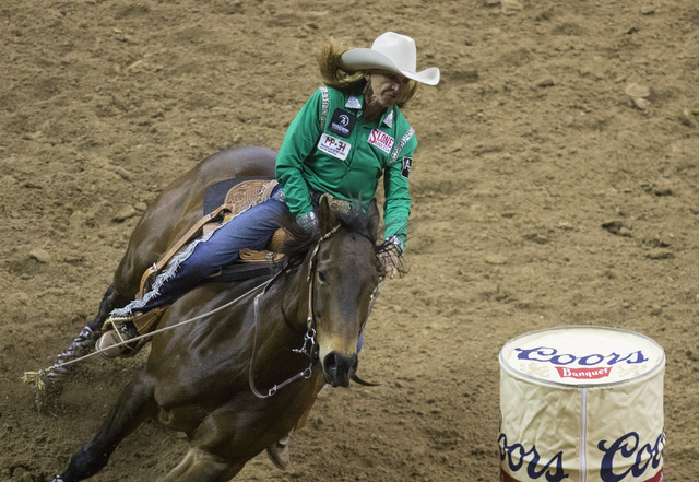 Pamela Capper competes in the barrel racing event during the fourth day of the National Finals Rodeo at the Thomas & Mack Center in Las Vegas on Sunday, Dec. 4, 2016.  Miranda Alam/Las Vegas R ...