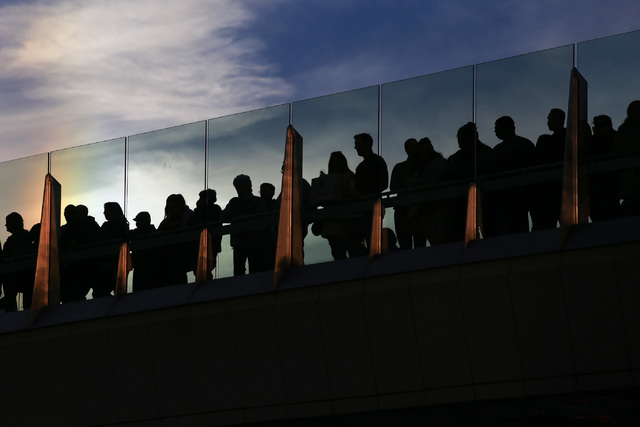 Fans wait for the NASCAR Victory Lap on the Spring Mountain Road pedestrian bridge in Las Vegas on Thursday, Dec. 1, 2016. (Brett Le Blanc/Las Vegas Review-Journal) Follow @bleblancphoto