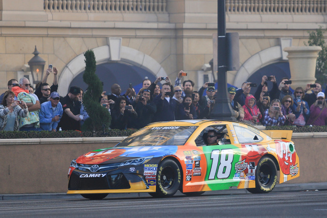 Kyle Busch (18) stops in front of the Palazzo hotel-casino during the NASCAR Victory Lap in Las Vegas on Thursday, Dec. 1, 2016. (Brett Le Blanc/Las Vegas Review-Journal) Follow @bleblancphoto