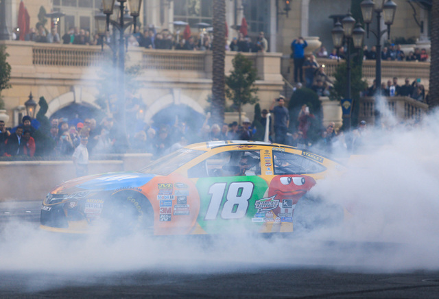 Kyle Busch (18) performs donuts infant of the Palazzo hotel-casino during the NASCAR Victory Lap in Las Vegas on Thursday, Dec. 1, 2016. (Brett Le Blanc/Las Vegas Review-Journal) Follow @bleblancphoto