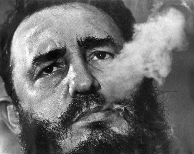 Cuban Prime Minister Fidel Castro exhales cigar smoke during an interview at his presidential palace in Havana, Cuba, in 1985. (Charles Tasnadi/File, AP)