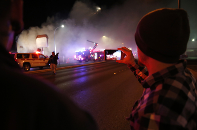 Las Vegas Fire & Rescue crews attack a two-alarm fire near Charleston Boulevard and 3rd Street in Las Vegas on Friday, Dec. 2, 2016. More than 60 firefighters responded. (Rachel Crosby/Las Veg ...