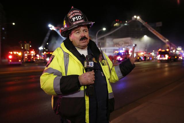 Las Vegas Fire & Rescue spokesman Tim Szymanski speaks to the media as crews attack a two-alarm fire near Charleston Boulevard and 3rd Street in Las Vegas on Friday, Dec. 2, 2016. More than 60 ...