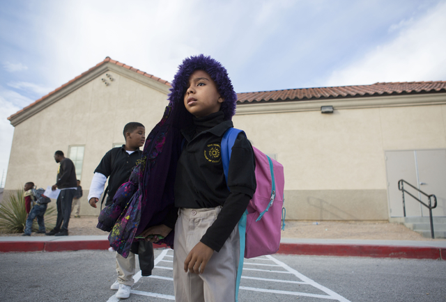 A student crosses the street after finishing a school day at the 100 Academy of Excellence, 2341 Comstock Drive, Wednesday, Nov. 30, 2016, North Las Vegas. (Elizabeth Brumley/Las Vegas Review-Jour ...
