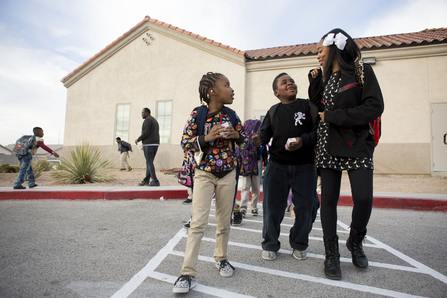 Ke'Veah Hopkins, left, Koty Preston, center, and Yasmine Preston, talk after finishing a school day at the 100 Academy of Excellence, 2341 Comstock Drive, Wednesday, Nov. 30, 2016, North Las Vegas ...
