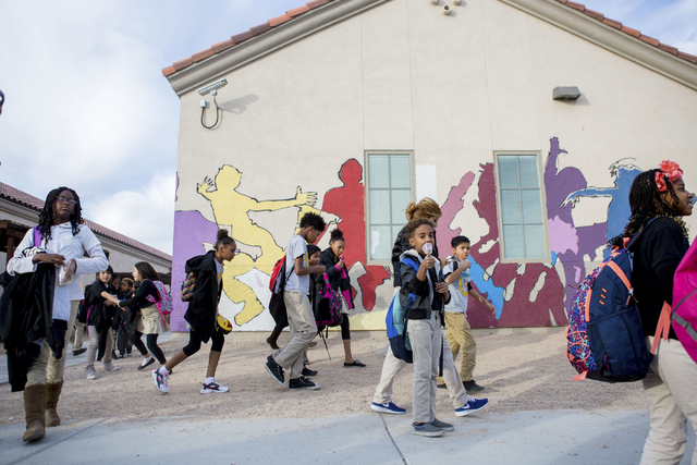 Students leave school after finishing for the day at the 100 Academy of Excellence, 2341 Comstock Drive, Wednesday, Nov. 30, 2016, North Las Vegas. (Elizabeth Brumley/Las Vegas Review-Journal @Eli ...