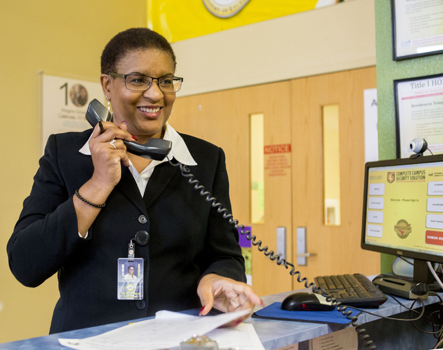 Rachelle Conner, principal of the 100 Academy of Excellence, 2341 Comstock Drive, gives the end-of-the-day announcements congratulating specific classrooms for their excellent work, Wednesday, Nov ...