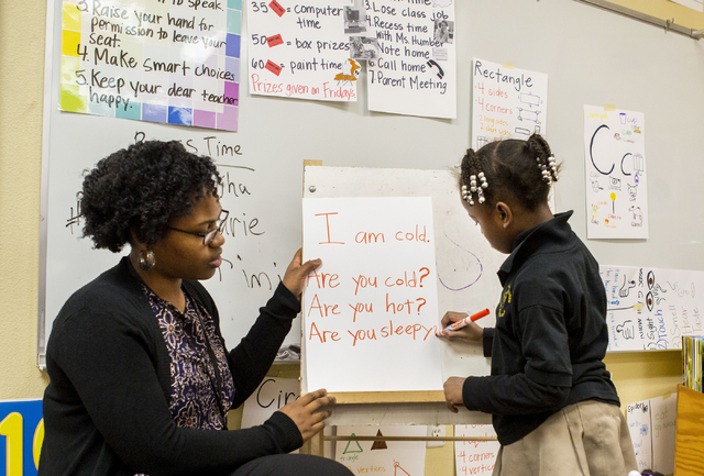 Amanda Humber, a kindergarten teacher, left, and Delilah Freeman, 5, works on punctuation at the 100 Academy of Excellence, 2341 Comstock Drive, Wednesday, Nov. 30, 2016, North Las Vegas. (Elizabe ...