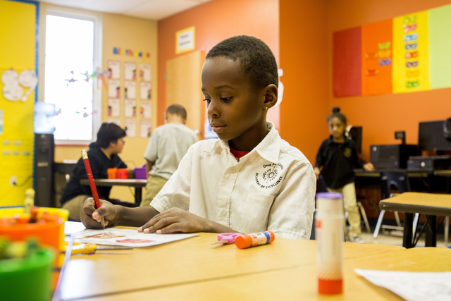 Dayleon Myers, 5, works on his spelling work in his kindergarten class at the 100 Academy of Excellence, 2341 Comstock Drive, Wednesday, Nov. 30, 2016, North Las Vegas. (Elizabeth Brumley/Las Vega ...