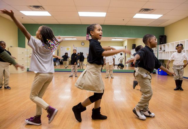 Mya McCullar, 7, left, Lariah Roberts, 8, center, and Myles Amani, 6, practice their dance for a school Christmas performance, at the 100 Academy of Excellence, 2341 Comstock Drive, Wednesday, Nov ...